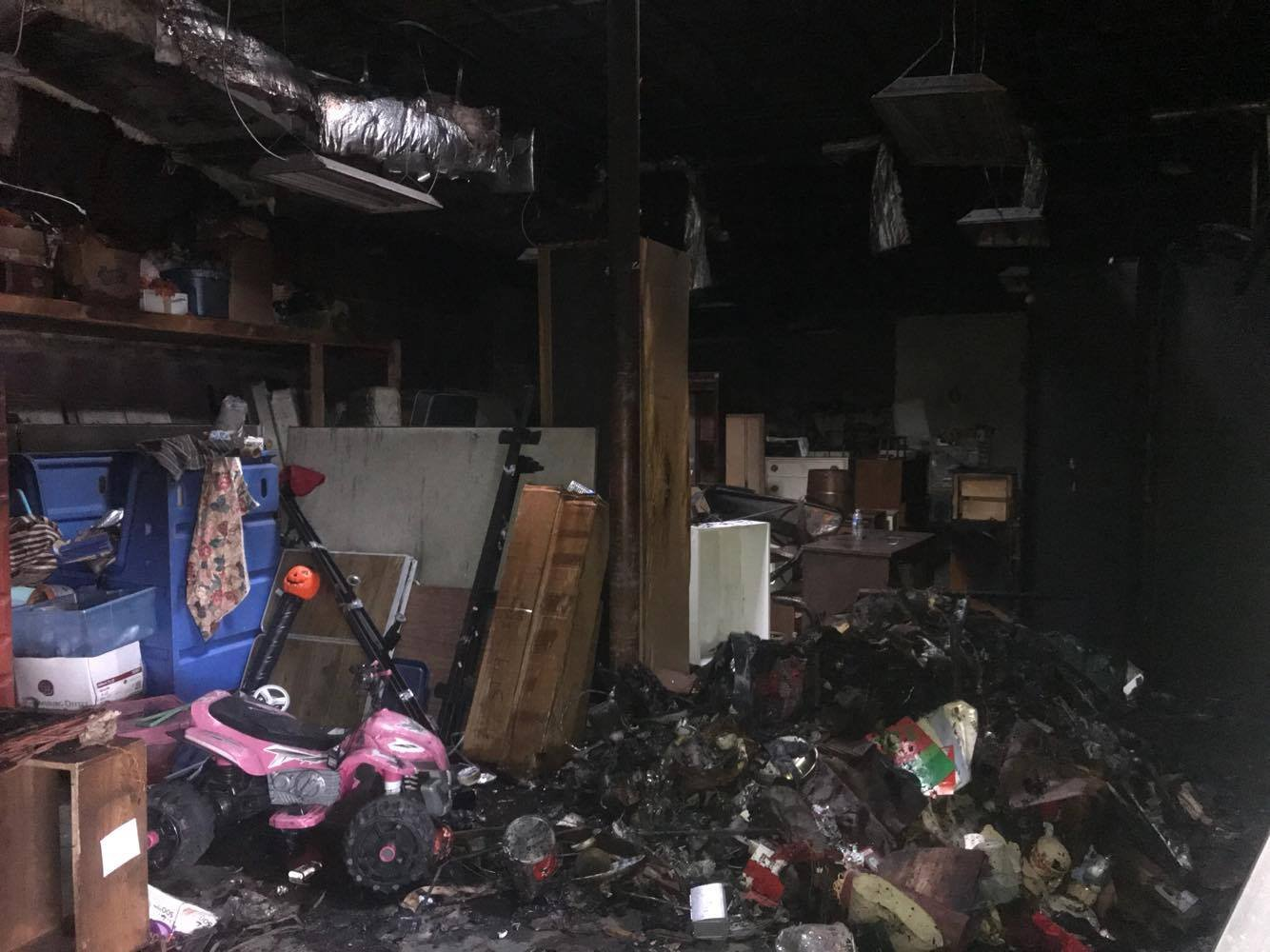 Heavy smoke made it hard for firefighters to navigate through the store's back room inventory to get to the flames.
